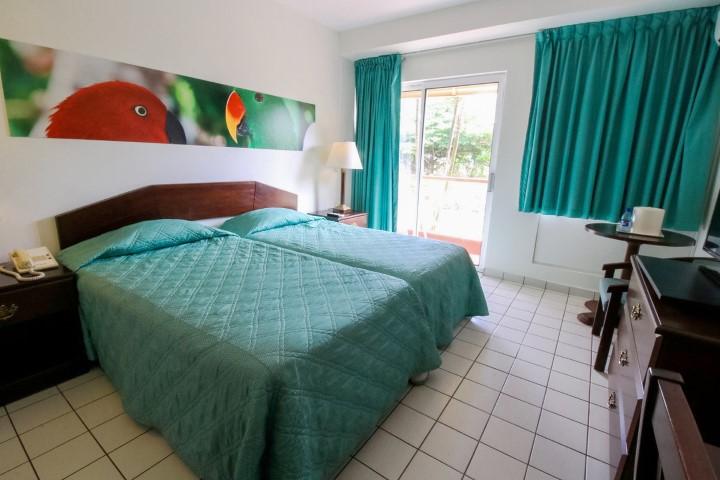 Eco resort inn vakantie suriname bij abc travel d specialist - Kamer heeft een mager ...